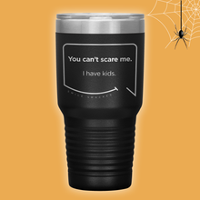 Our funny quotes make the best gifts for Mom! Perfect for Halloween. Front view of our extreme 30 oz black travel mug. The modern etched quote bubble reads: You can't scare me. I have kids.