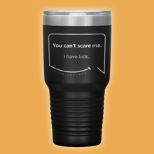 Our funny quotes make the best gifts for Mom! Front view of our extreme 30 oz black travel mug. The modern etched quote bubble reads: You can't scare me. I have kids.