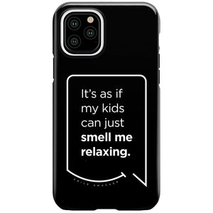 Our funny quotes make the best gifts for Mom! This front view of our slim yet durable black iPhone 11 Pro tough case has a modern white quote bubble that reads: It's as if my kids can just smell me relaxing.