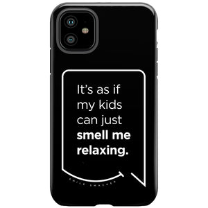 Our funny quotes make the best gifts for Mom! This front view of our slim yet durable black iPhone 11 tough case has a modern white quote bubble that reads: It's as if my kids can just smell me relaxing.
