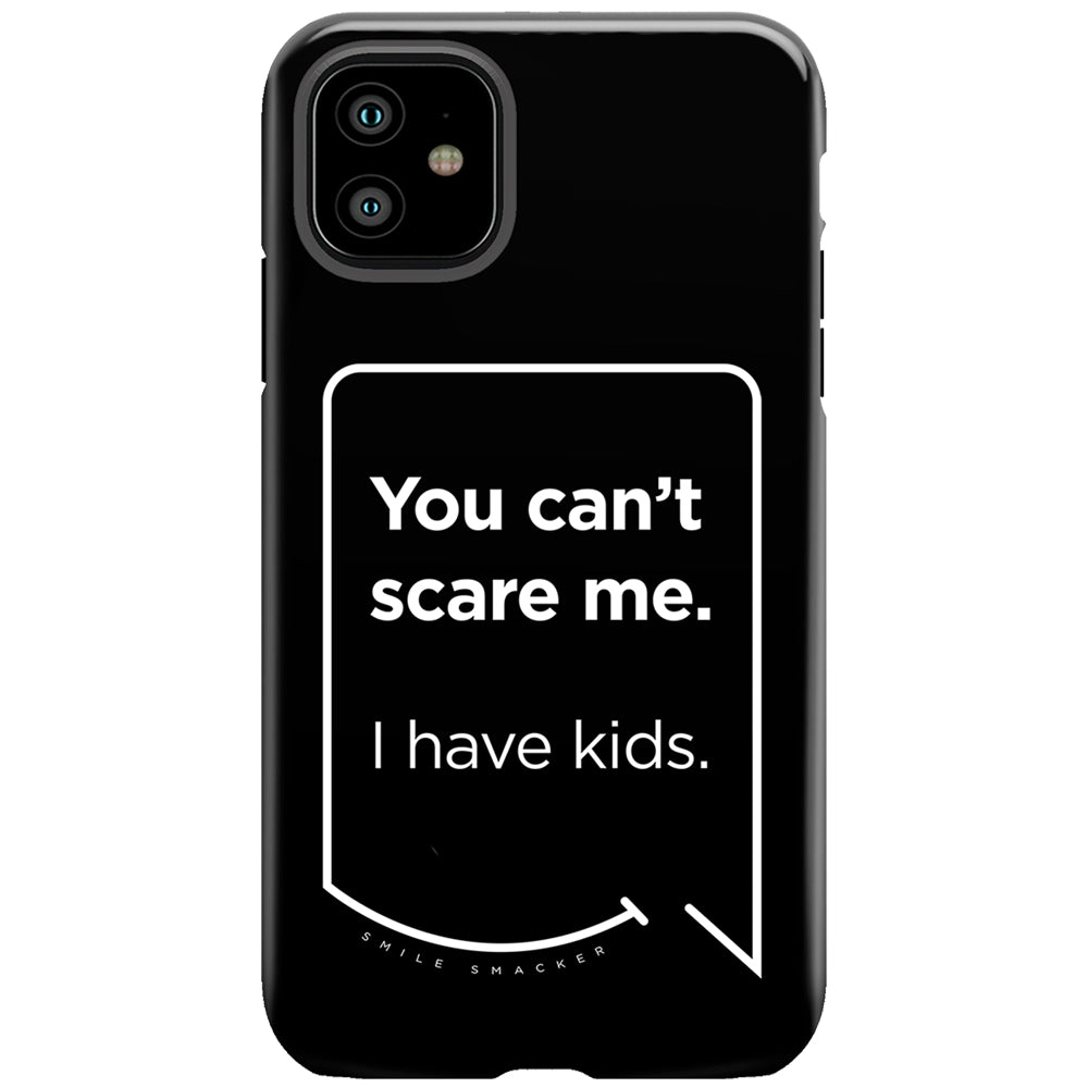 Our funny quotes make the best gifts for Mom! This front view of our slim yet durable black iPhone 11 tough case has a modern white quote bubble that reads: You can't scare me. I have kids.