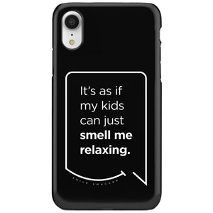 Our funny quotes make the best gifts for Mom! This front view of our slim yet durable black iPhone XR tough case has a modern white quote bubble that reads: It's as if my kids can just smell me relaxing.
