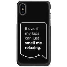 Our funny quotes make the best gifts for Mom! This front view of our slim yet durable black iPhone XS & XS Max tough cases have a modern white quote bubble that reads: It's as if my kids can just smell me relaxing.