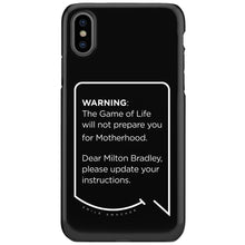 Our funny quotes make the best gifts for Mom! This front view of our slim yet durable black iPhone XS & XS Max tough cases have a modern white quote bubble that reads: Warning: The Game of Life will not prepare you for Motherhood. Dear Milton Bradley, please update your instructions.