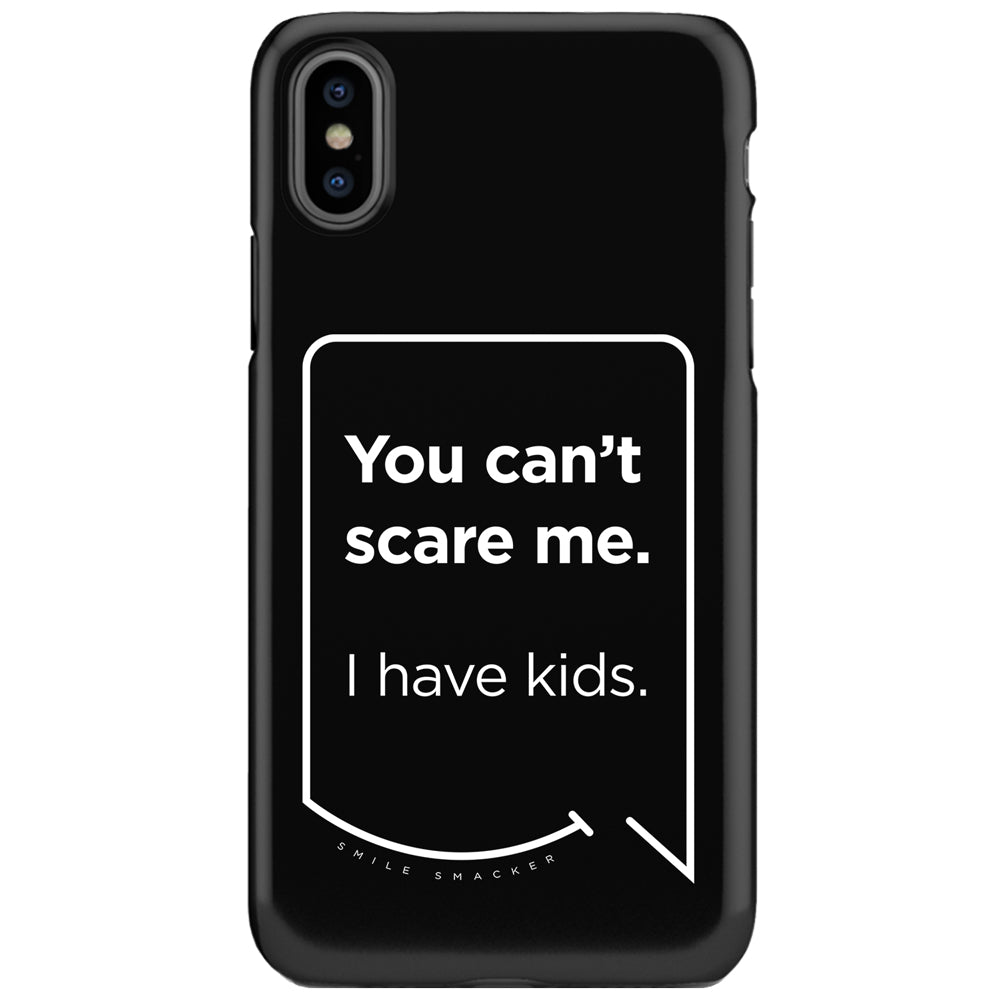 Our funny quotes make the best gifts for Mom! This front view of our slim yet durable black iPhone XS & XS Max tough cases have a modern white quote bubble that reads: You can't scare me. I have kids.