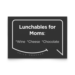 Our funny quotes make the best gifts for Mom! Front view of our trendy black note card. The modern white quote bubble reads: Lunchables for Moms: wine, cheese, chocolate.