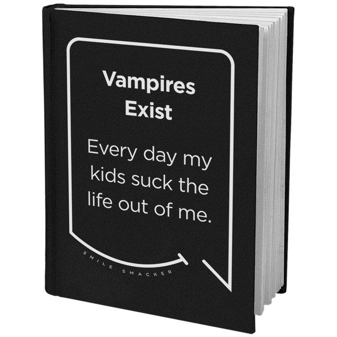 Our funny quotes make the best gifts for Mom! Angled view of our sleek black notebook. The modern white quote bubble reads: Vampires Exist. Every day my kids suck the life out of me.
