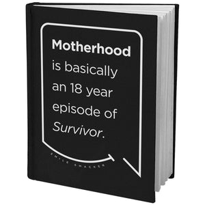 Our funny quotes make the best gifts for Mom! Angled view of our sleek black notebook. The modern white quote bubble reads: Motherhood is basically an 18 year episode of Survivor.