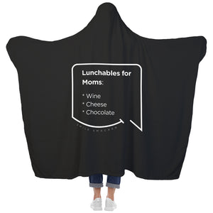 Our funny quotes make the best gifts for Mom! View of our cozy Super-Mom blanket from the back as a Mom holds her arms out to reveal the spacious length and width. The modern white quote bubble reads: Lunchables for Moms: wine, cheese, chocolate.