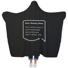 Our funny quotes make the best gifts for Mom! View of our cozy Super-Mom blanket from the back as a Mom holds her arms out to reveal the spacious length and width. The modern white quote bubble reads: Mom, Mommy, Mama. There are lots of ways to say the word Mother. And my kid knows Every. Single. One.