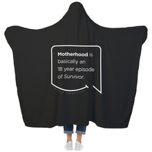 Our funny quotes make the best gifts for Mom! View of our cozy Super-Mom blanket from the back as a Mom holds her arms out to reveal the spacious length and width. The modern white quote bubble reads: Motherhood is basically an 18 year episode of Survivor.