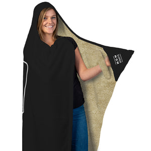 "Our funny quotes make the best gifts for Mom! Full length, front view of our cozy Super-Mom blanket with fleece wrist straps, as a Mom holds her left arm out to reveal the words ""Super Mom"" printed on the black mitten pocket."