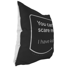 Our funny quotes make the best gifts for Mom! This side view of our chic throw pillow shows the contrast between the white back and black front, with a modern white quote bubble that reads: You can't scare me. I have kids.
