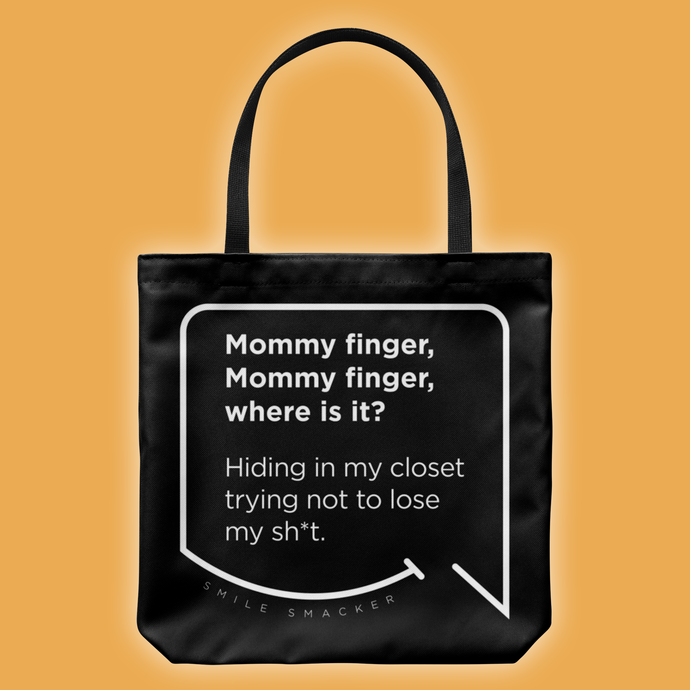 Our funny quotes make the best gifts for Mom! Front view of our large black tote bag. The modern white quote bubble reads: Mommy Finger, Mommy Finger where is it? Hiding in my closet trying not to lose my sh*t.