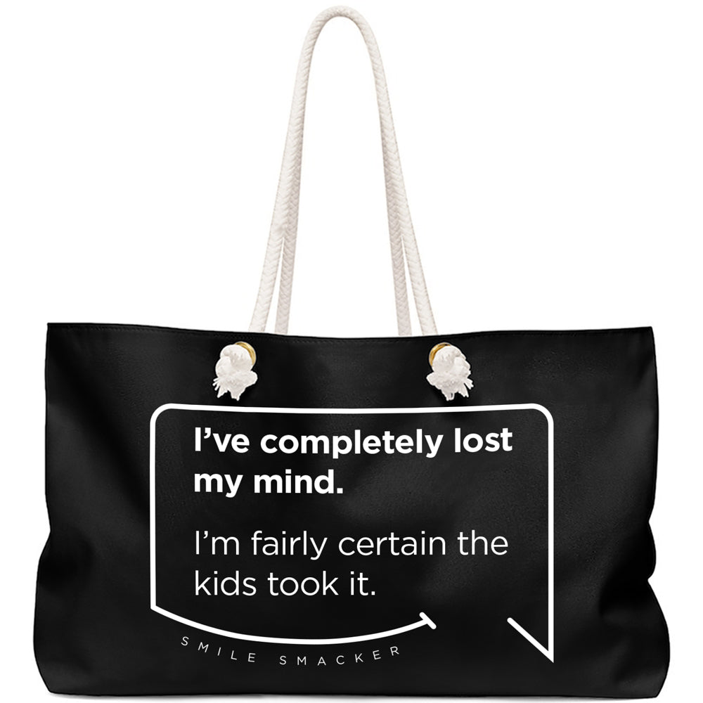 Our funny quotes make the best gifts for Mom! Front view of our large, black, double-sided weekender bag. The modern white quote bubble reads: I've completely lost my mind. I'm fairly certain the kids took it.