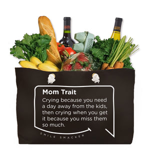 Our funny quotes make the best gifts for Mom! Front view of our large, black, double-sided weekender bag filled with groceries. The modern white quote bubble reads: Mom Trait: Crying because you need a day away from the kids, then crying when you get it because you miss them so much.