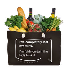 Our funny quotes make the best gifts for Mom! Front view of our large, black, double-sided weekender bag filled with groceries. The modern white quote bubble reads: I've completely lost my mind. I'm fairly certain the kids took it.
