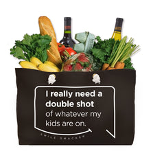 Our funny quotes make the best gifts for Mom! Front view of our large, black, double-sided weekender bag filled with groceries. The modern white quote bubble reads: I really need a double shot of whatever my kids are on.