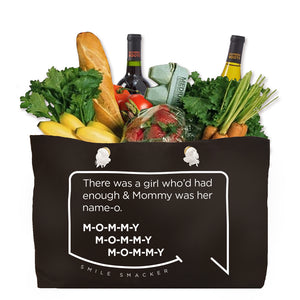Our funny quotes make the best gifts for Mom! Front view of our large, black, double-sided weekender bag filled with groceries. The modern white quote bubble reads: There was a girl who'd had enough and Mommy was her name-o. M-O-M-M-Y. M-O-M-M-Y. M-O-M-M-Y.