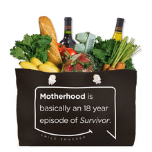 Our funny quotes make the best gifts for Mom! Front view of our large, black, double-sided weekender bag filled with groceries. The modern white quote bubble reads: Motherhood is basically an 18 year episode of Survivor.