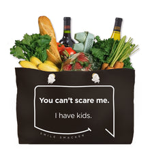 Our funny quotes make the best gifts for Mom! Front view of our large, black, double-sided weekender bag filled with groceries. The modern white quote bubble reads: You can't scare me. I have kids.