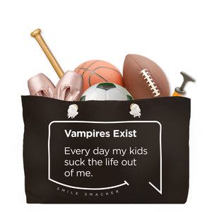 Our funny quotes make the best gifts for Mom! Front view of our large, black, double-sided weekender bag filled with dance and sports equipment. The modern white quote bubble reads: Vampires Exist. Every day my kids suck the life out of me.