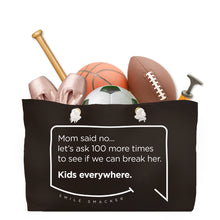 Our funny quotes make the best gifts for Mom! Front view of our large, black, double-sided weekender bag filled with dance and sports equipment. The modern white quote bubble reads: Mom said no... let's ask 100 more times to see if we can break her. Kids everywhere.