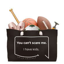 Our funny quotes make the best gifts for Mom! Front view of our large, black, double-sided weekender bag filled with dance and sports equipment. The modern white quote bubble reads: You can't scare me. I have kids.