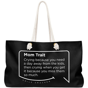 Our funny quotes make the best gifts for Mom! Front view of our large, black, double-sided weekender bag. The modern white quote bubble reads: Mom Trait: Crying because you need a day away from the kids, then crying when you get it because you miss them so much.