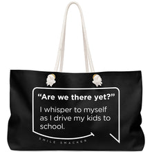 Our funny quotes make the best gifts for Mom! Front view of our large, black, double-sided weekender bag. The modern white quote bubble reads: Are we there yet? I whisper to myself as I drive my kids to school.