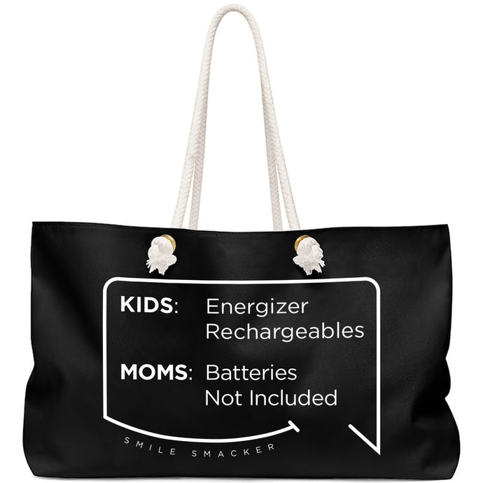 Our funny quotes make the best gifts for Mom! Front view of our large, black, double-sided weekender bag. The modern white quote bubble reads: Kids: Energizer Rechargeables. Moms: Batteries Not Included.