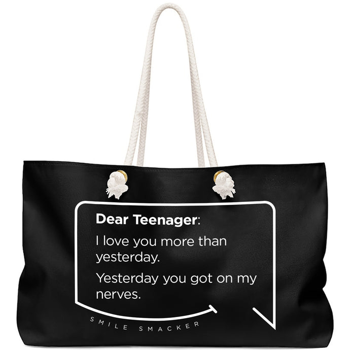 Our funny quotes make the best gifts for Mom! Front view of our large, black, double-sided weekender bag. The modern white quote bubble reads: Dear Teenager: I love you more than yesterday. Yesterday you got on my nerves.