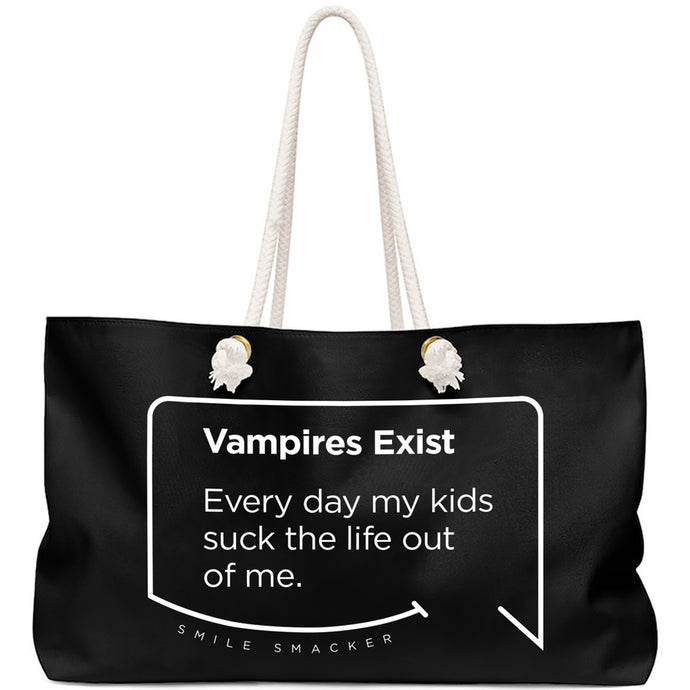 Our funny quotes make the best gifts for Mom! Front view of our large, black, double-sided weekender bag. The modern white quote bubble reads: Vampires Exist. Every day my kids suck the life out of me.