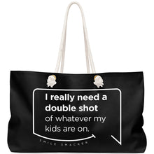 Our funny quotes make the best gifts for Mom! Front view of our large, black, double-sided weekender bag. The modern white quote bubble reads: I really need a double shot of whatever my kids are on.