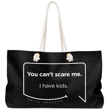 Our funny quotes make the best gifts for Mom! Front view of our large, black, double-sided weekender bag. The modern white quote bubble reads: You can't scare me. I have kids.