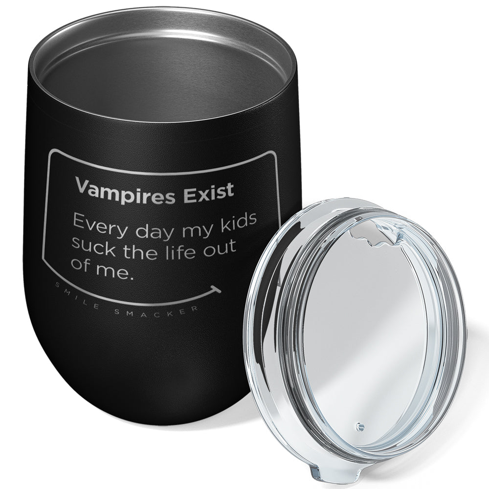 Our funny quotes make the best gifts for Mom! Overhead view of our chic black wine tumbler. The modern etched quote bubble reads: Vampires Exist. Every day my kids suck the life out of me.