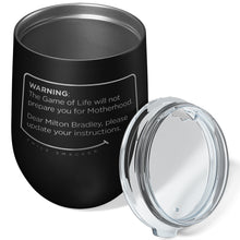 Our funny quotes make the best gifts for Mom! Overhead view of our chic black wine tumbler. The modern etched quote bubble reads: Warning: The Game of Life will not prepare you for Motherhood. Dear Milton Bradley, please update your instructions.