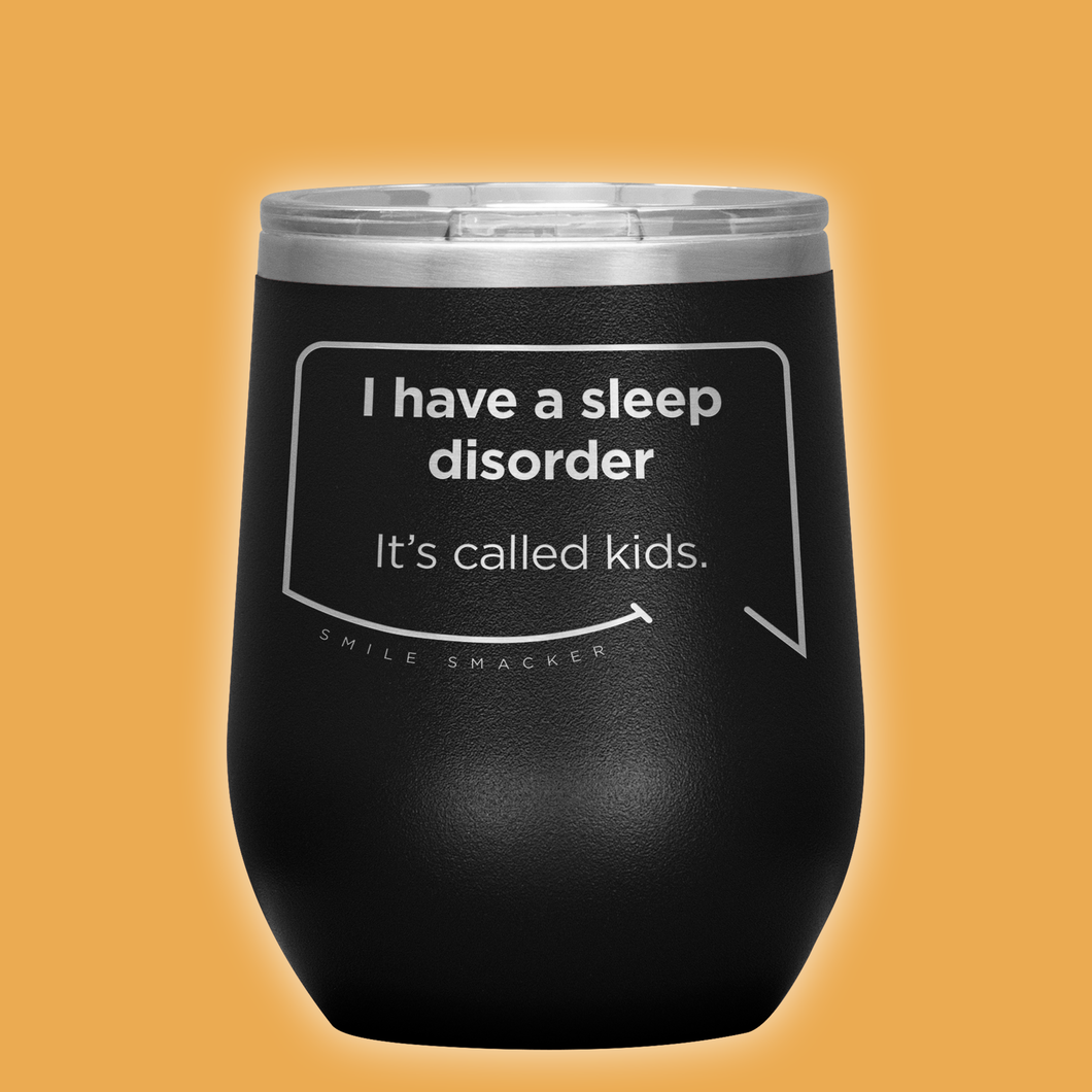 Our funny quotes make the best gifts for Mom! Front view of our chic black wine tumbler. The modern etched quote bubble reads: I have a sleep disorder. It's called kids.