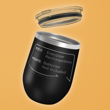 Our funny quotes make the best gifts for Mom! Tilted view of our chic black wine tumbler with a clear lid. The modern etched quote bubble reads: Kids: Energizer Rechargeables. Moms: Batteries Not Included.