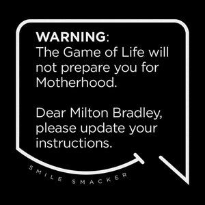 Our funny quotes make the best gifts for Mom! Front view of our trendy black wall art canvas. The modern white quote bubble reads: Warning: The Game of Life will not prepare you for Motherhood. Dear Milton Bradley, please update your instructions.