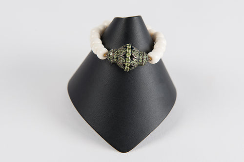 Bone with peridot focal bead
