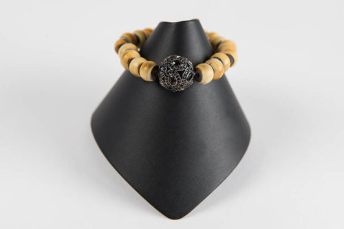 Horn with black spinel bead