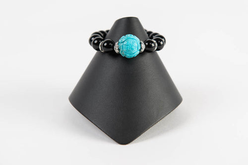 Black onyx with carved natural turquoise