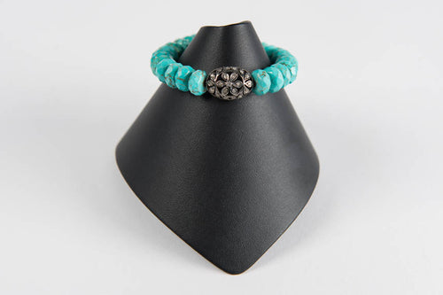 Turquoise rondelle with pave diamond bead