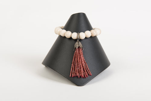 Blush garnet and pave diamond tassel on neutral agate