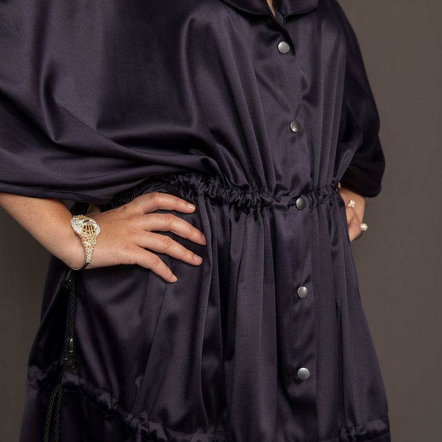 Navy satin gown with front poppers, shawl collar and adjustable drawstrings by Kim Dave