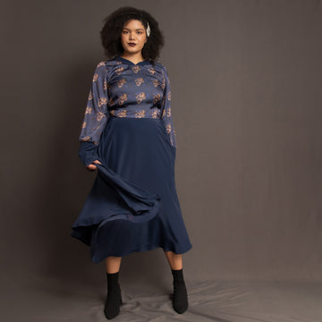 Navy blue midi dress with circle skirt and long sleeves by Kim Dave