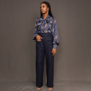 Navy high waisted trousers with wide leg and front double welt pockets by Kim Dave
