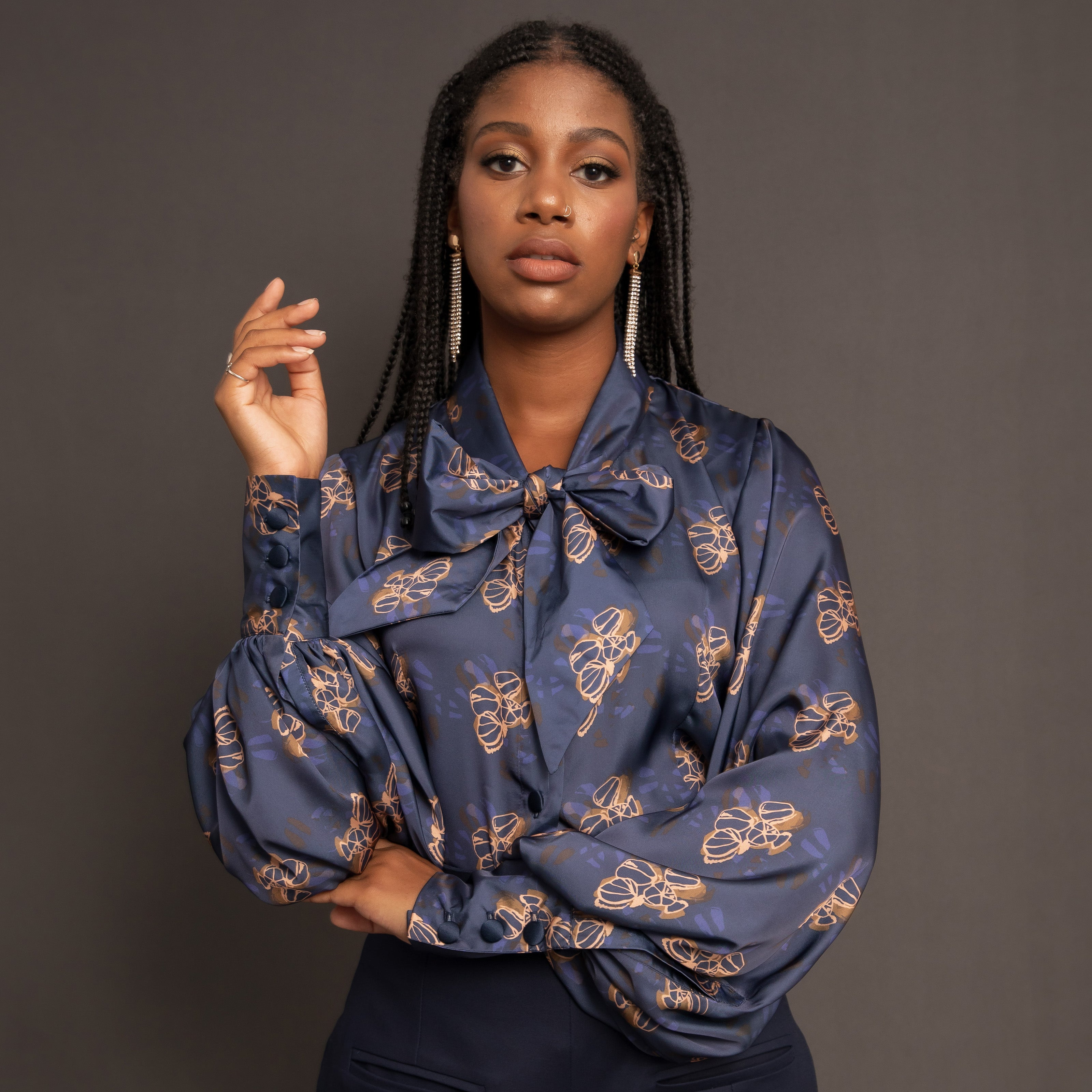 Navy print silk sateen blouse with balloon sleeve and pussy bow detail.