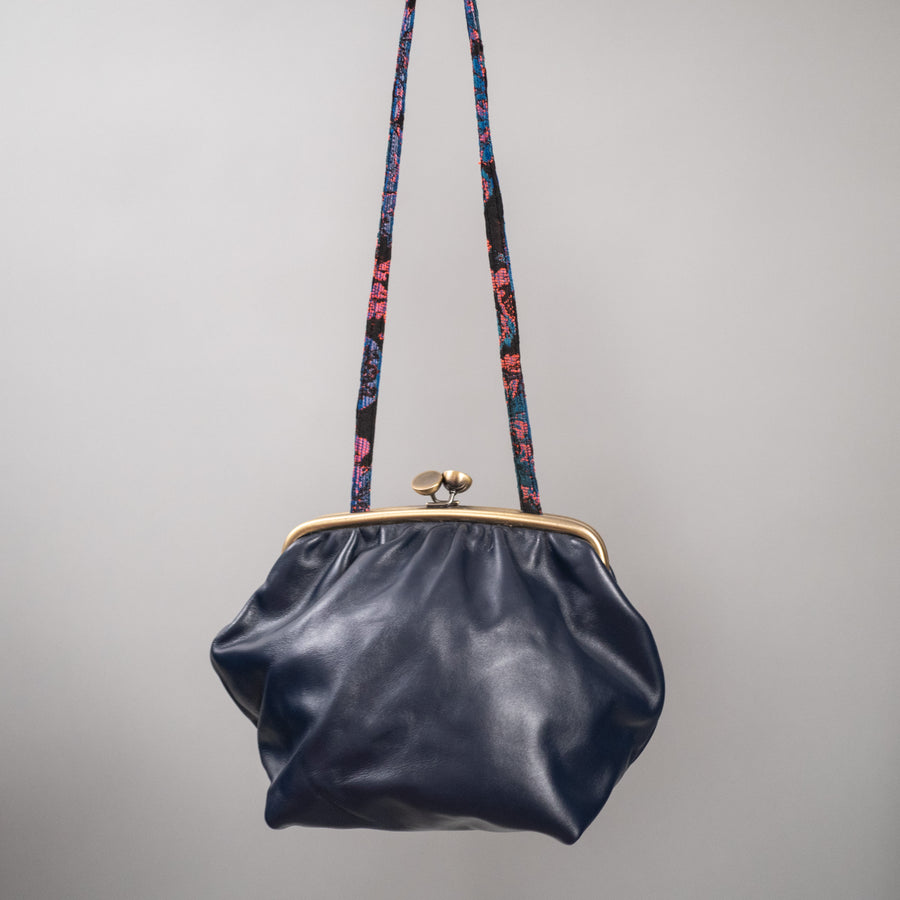Navy blue leather clutch with brass hardware